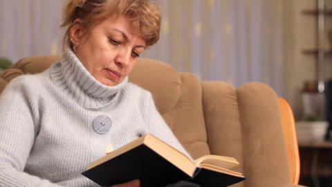 woman reads book Footage