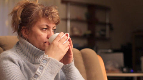 woman drinks tea Stock Video Footage