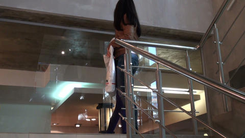 The girl on the stairs in the business centre Footage