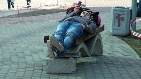 The guy has a rest on bench Stock Video Footage