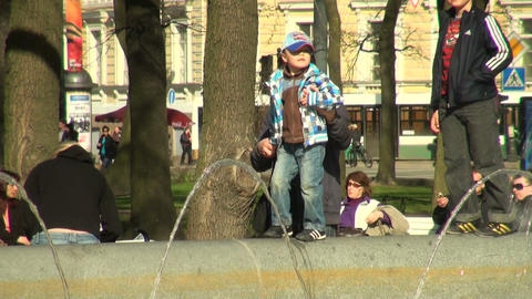 The kid is on the edge of the fountain Footage