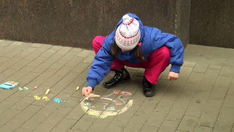 The child draws with chalk Stock Video Footage