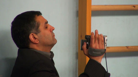 A man takes on the camcorder Stock Video Footage
