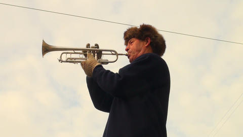 Trumpeter playing in the street Stock Video Footage
