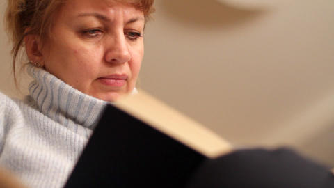 woman reads book Stock Video Footage
