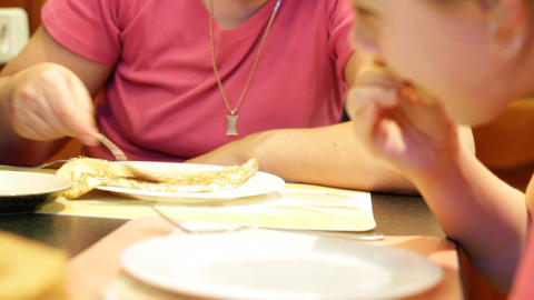 Mum With Daughter Eat Pancakes stock footage