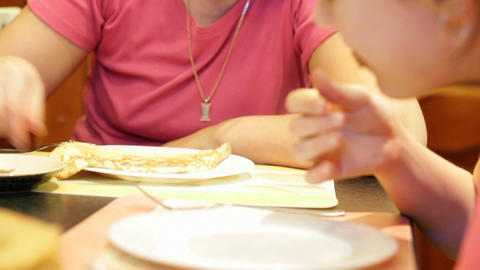 Mum with daughter eat pancakes Stock Video Footage