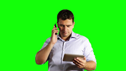 Young Businessman Tablet PC and Cell Phone Broken Greenscreen 44 Footage