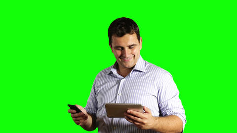 Young Businessman Tablet PC and Cell Phone Good Connection Greenscreen 46 Footage