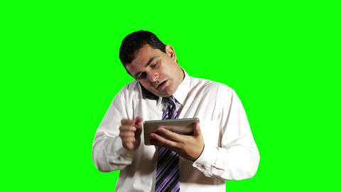 Young Businessman Tablet PC and Cell Phone Greenscreen 8 Stock Video Footage