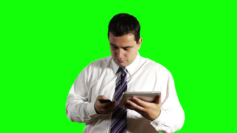 Young Businessman Tablet PC and Cell Phone Greenscreen 8 Footage