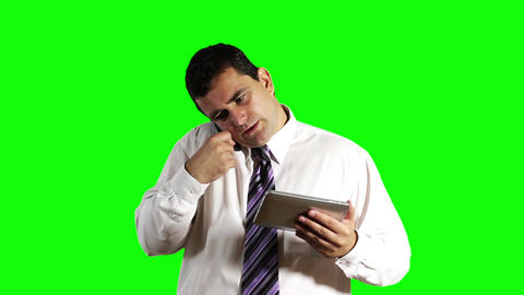 Young Businessman Tablet PC and Cell Phone Greenscreen 11 Stock Video Footage