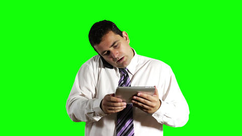 Young Businessman Tablet PC and Cell Phone Greenscreen 11 Footage