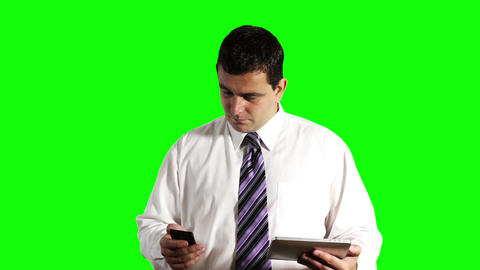 Young Businessman Tablet PC and Cell Phone Greenscreen 13 Footage