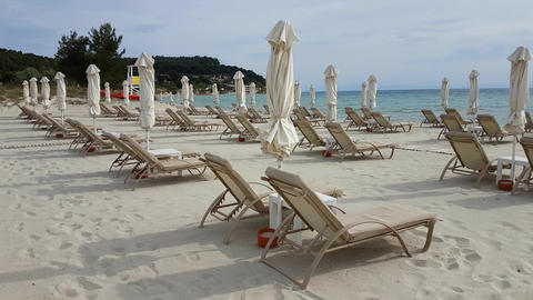 Sunbeds with closed umbrellas at Halkidiki, Greece Footage