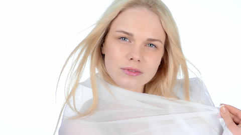Wind blowing hair blonde girl on a white background Footage