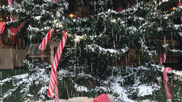 Synthetic Snow Falling on Indoor Christmas Tree Stock Video Footage