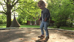 Toddler Walking on Backyard Trampoline and Jumping Live Action