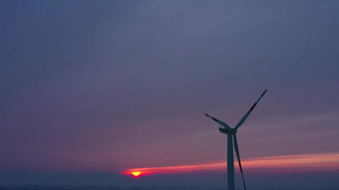 Silhouette of energy producing wind turbines at sunset, Poland 영상물