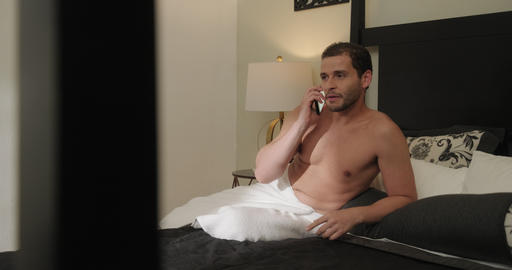 Gay Man Calling Partner On Mobile Phone In Hotel Room GIF