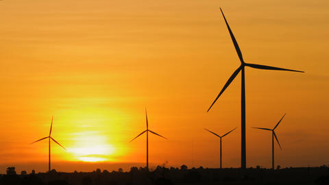 Silhouette of wind turbine over sunset ecology energy concept for electric maker Footage