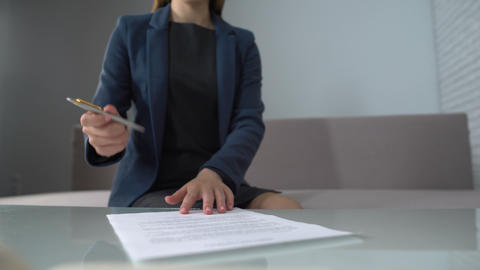 Woman signing documents to receive money, taking loan in bank, startup business Footage