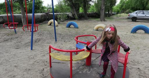 Girl child on carousel Archivo