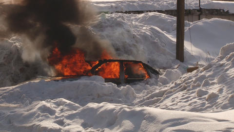 Car burns in snow Footage