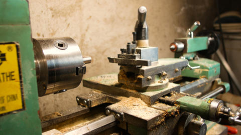 passionate DIY man, he uses the lathe for DIY, in his home laboratory, precision Live Action