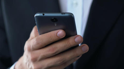 Hand of businessman holding smartphone checking personal mail box, technology Footage