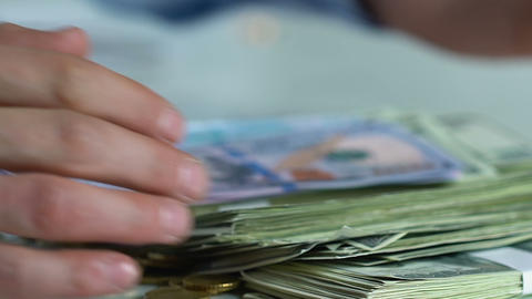 Close-up male hands taking lot of money, repayment of debt, interest on loan Footage