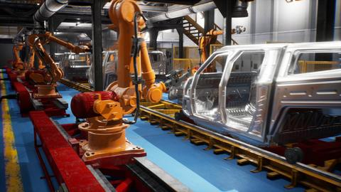 Car welding line of conveyor with frameworks of unfinished cars and robots フォト