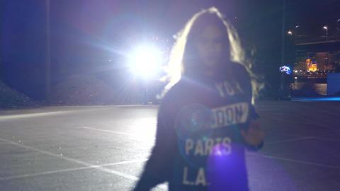 Girl dancing in spotlight on the street for video clip 영상물