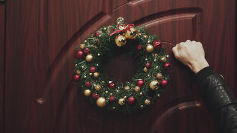 Wreath Christmas on the door. Broaching view of the door decorated for Christmas Footage