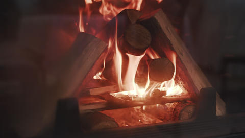 Burning Fire In The Fireplace. Slow motion. A looping clip of a fireplace with GIF