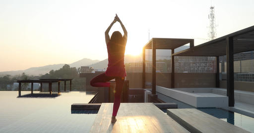 Anonymous female doing yoga on roof Footage