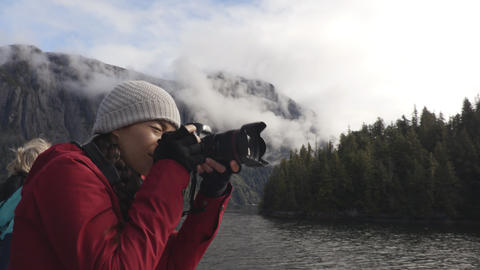 Alaska tourist photographer enjoying travel vacation cruise in Misty Fiords Live Action