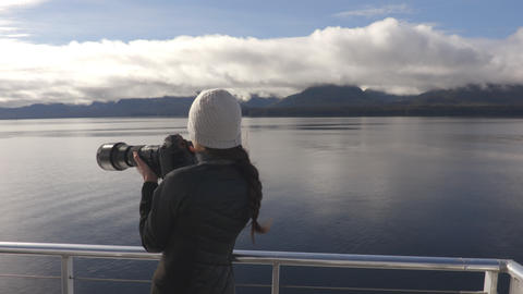 Alaska tourist wildlife photographer on travel vacation cruise in Misty Fiords Live Action