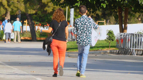 Couple Walks On The Sunny Street Footage