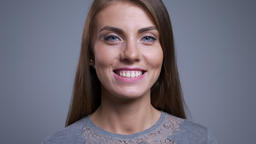 Closeup portrait of happy young caucasian woman smiling and looking straight at Footage