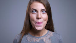 Closeup portrait of cheerful young caucasian female being surprised smiling and Footage
