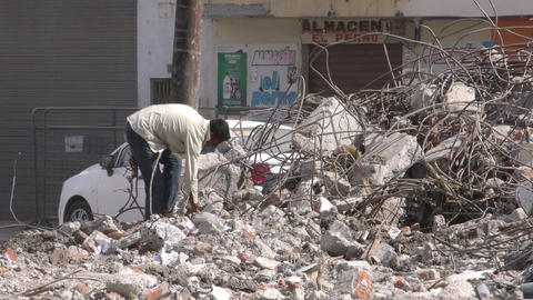 man searching for precious cooper wire in earthquake destroyed building Footage