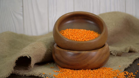 Red lentils in a wooden bowl on the table Footage