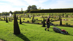 Mowing the grass at the Formal Garden Hampton Court UK Footage