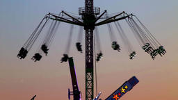 Fairground attractions at sunset 영상물