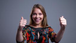 Closeup portrait of attractive young caucasian woman raising her eyebrow up ビデオ