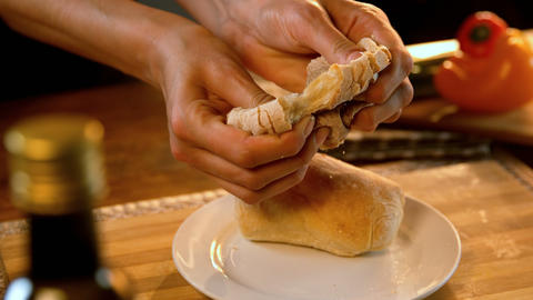 Woman tearing bread into half 4k Live Action