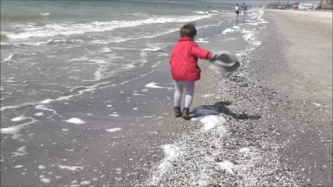 boy walking on a winter beach Footage