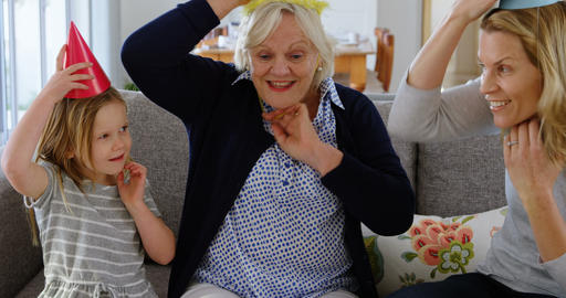 Family celebrating birthday on sofa 4k Live Action
