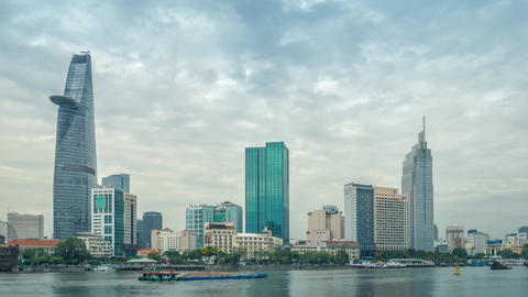 Time lapse of Ho Chi Minh City skyline and the Saigon River on a cloudy day GIF